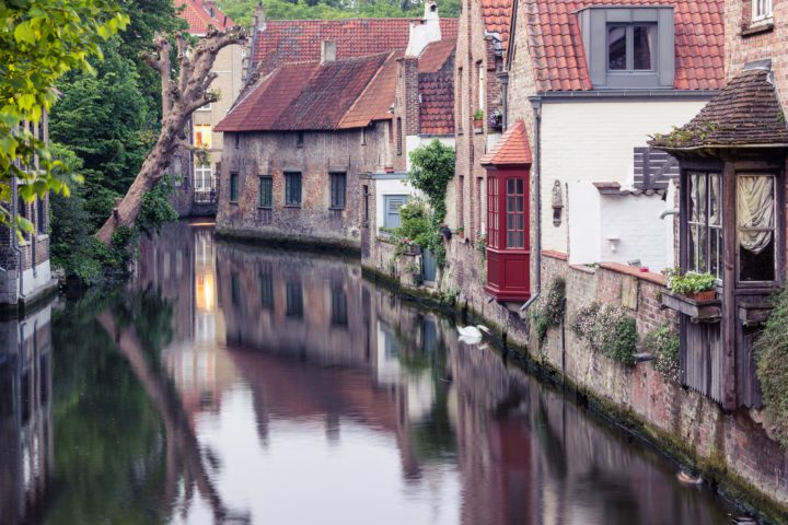 Bruges in Flanders with river and houses.